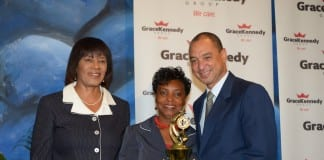 (From left) Prime Minister Portia Simpson-miller, Rosetta Steer and GraceKennedy Group CEP Don Wehby