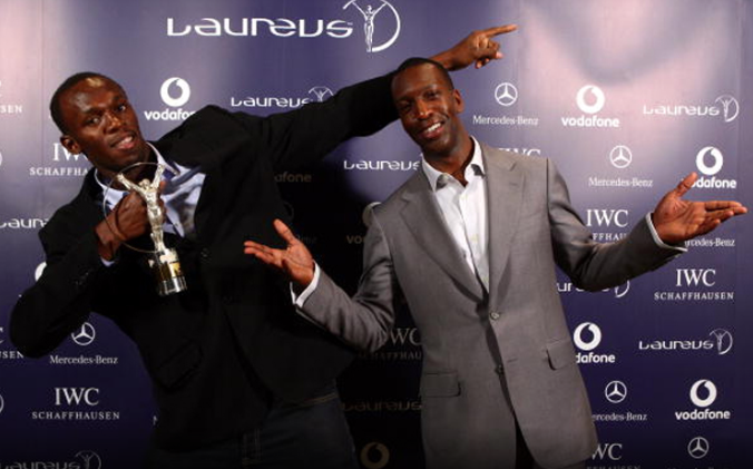 Usain Bolt (JAM) World record holder for 100m and 200m, poses with Academy Member Michael Johnson (R) after receiving the Laureus World Sportsman of the year award during a ceremony and press conference held at The Four Seasons Hotel on June 10, 2009 in Toronto, Ontario. (Photo by John Gichigi/Getty Images for Laureus) *