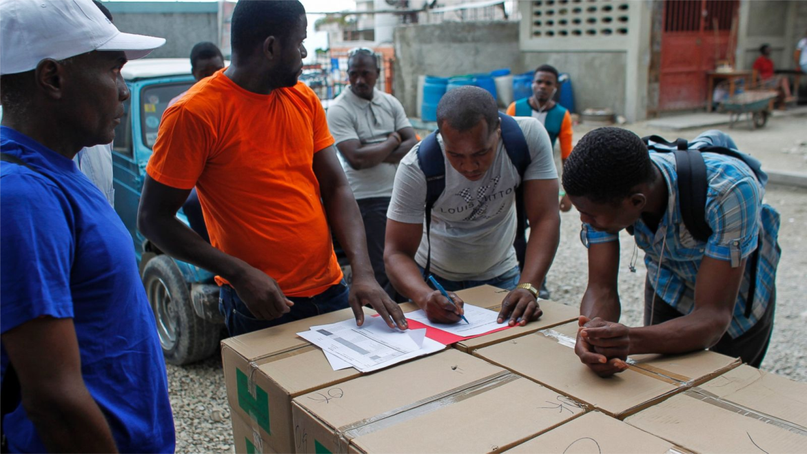 haiti-counting-ballots-voters-fill-out-forms