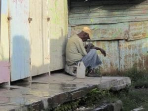 An eldery resident of Majesty gardens chills outside his residence which is nestled in the former constituency of Portia Simpson Miller