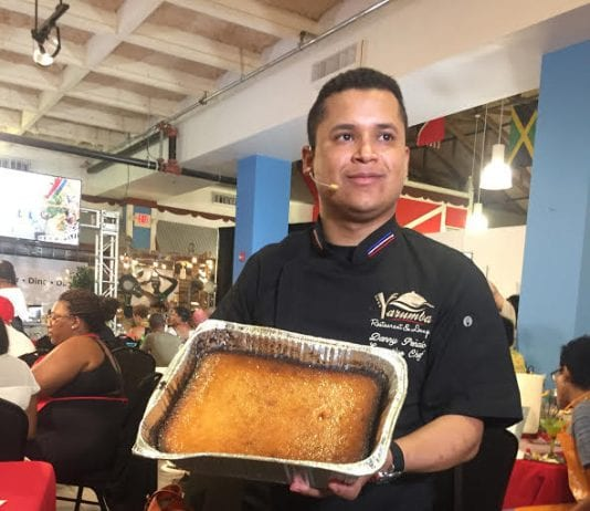 Chef Danny shows off his Dulce De Coco Al Horno, a coconut-baked pudding with ice cream - Caribbean National Weekly News