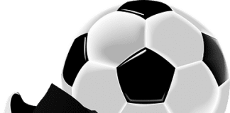 soccer ball and cleat - Caribbean National Weekly News