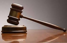 court room gavel comes down in case of identity fraud - Caribbean National Weekly News