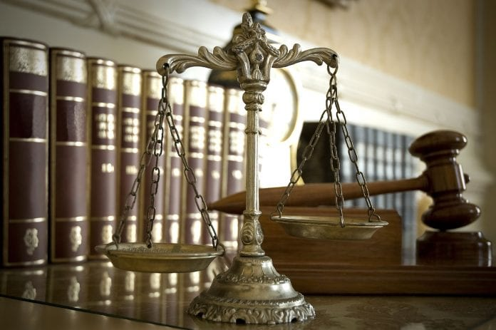 Judicial scales balance the issue of youths tried as adults - Caribbean National Weekly News
