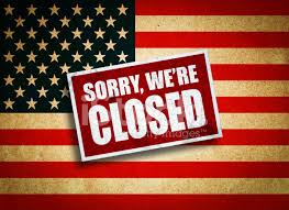 American Flag with Sorry we're closed sign closed to immigrants - Caribbean National Weekly News