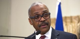 PM mum on new Haitian army