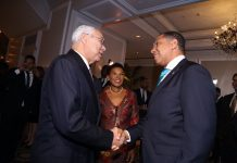 colin powell with Andrew Holness